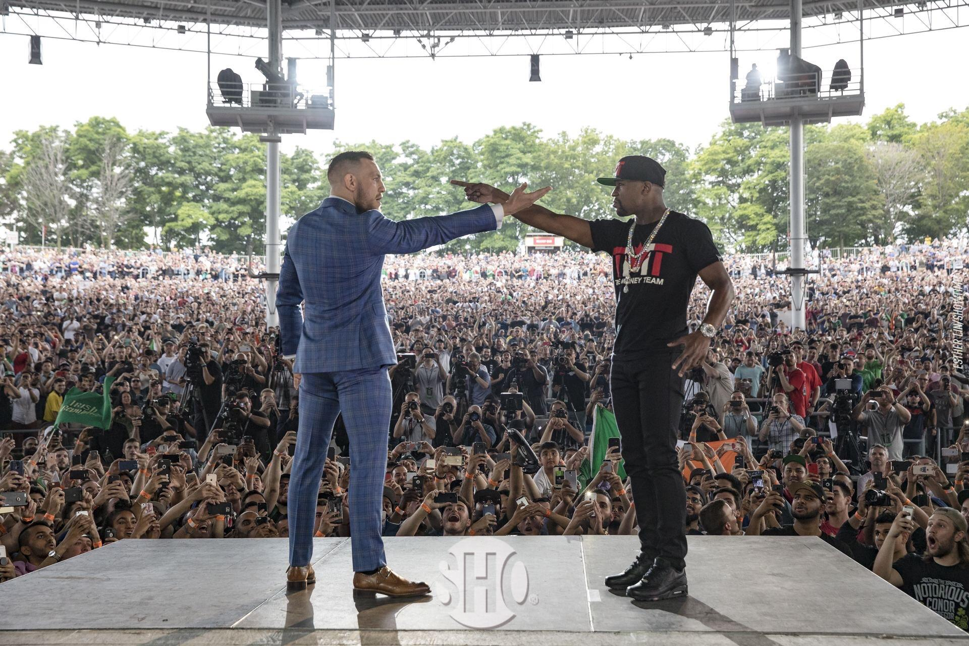 Conor McGregor and Floyd Mayweather come face to face.