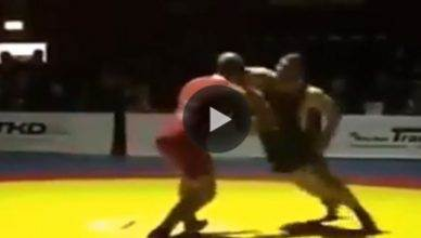 Wrestling KO during a match after a frustrated wrestler throws an elbow and knocks out his opponent.