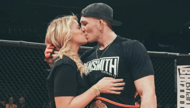 UFC strawweight star Paige VanZant was cageside to give her new man a big congratulatory kiss after his big win this past weekend.