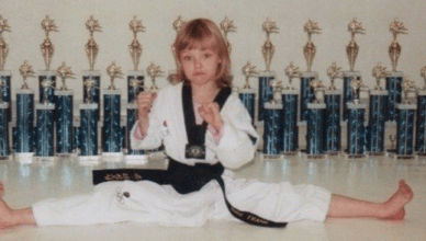 "Check out new UFC strawweight champion ""Thug"" Rose Namajunas as a young girl showing off all her karate tournament trophies."