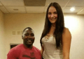 Anthony Johnson looks tiny next to her.